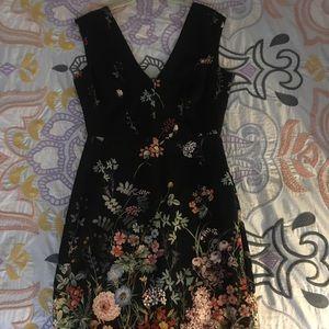 Floral knee length dress.